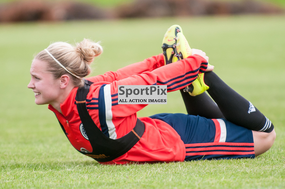 Kim Little stretches during the Scotland Women's team training session at Stepps Playing Fields in Glasgow ahead of their World Cup Qualifier with Sweden, 12 June 2014. (c) Paul J Roberts / Sportpix.org.uk