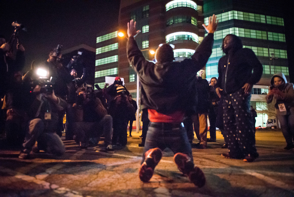 Protestor reacts to the grand jury announcement that officer Darren Wilson will not face criminal charges in the shooting of Michael Brown outside the St. Louis County Courthouse in Clayton, Missouri on November 24, 2014. REUTERS/Kate Munsch (United States)