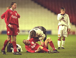 LIVERPOOL, ENGLAND - Tuesday, January 7, 1997: Liverpool's Frank Skelly treats an injured player against Manchester United during the FA Youth Cup match at Anfield. United won 2-1. (Pic by David Rawcliffe/Propaganda)