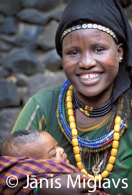A Konso woman with a child, in her village in the Omo region of Ethiopia, Africa.