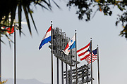 LOS ANGELES, CA - MAY 27:  Flags fly over the stadium while framed by trees and light stands before the Los Angeles Dodgers game against the Houston Astros on Sunday, May 27, 2012 at Dodger Stadium in Los Angeles, California. The Dodgers won the game 5-1. (Photo by Paul Spinelli/MLB Photos via Getty Images)