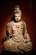 Stone Buddha figure of Bodhisattva on display in the Shanghai Museum, China