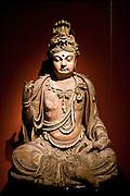 Stone Buddha figure of Bodhisattva on display in the Shanghai Museum, China