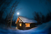 A warm cabin in the Yukon's back country in winter.