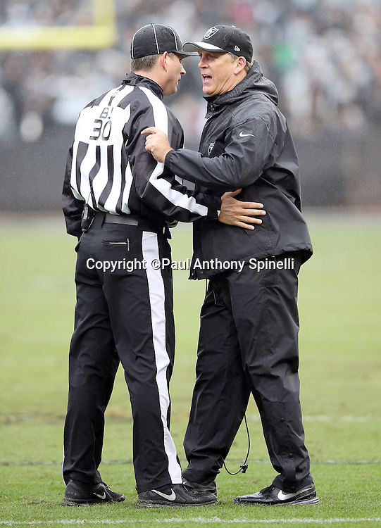 Oakland Raiders head coach Jack Del Rio yells at back judge Todd Prukop (30) during the 2015 week 15 regular season NFL football game against the Green Bay Packers on Sunday, Dec. 20, 2015 in Oakland, Calif. The Packers won the game 30-20. (©Paul Anthony Spinelli)