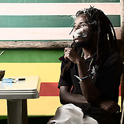 Portrait of Ras Fitsum, Shashamane, Ethiopia.<br /> <br /> Ras Fitsum is one of the few Ethiopian Rastafarians in Shashamane.<br /> <br /> Smoking ganja is part of the spiritual being of Rastafarians and helps facilitate meditation.