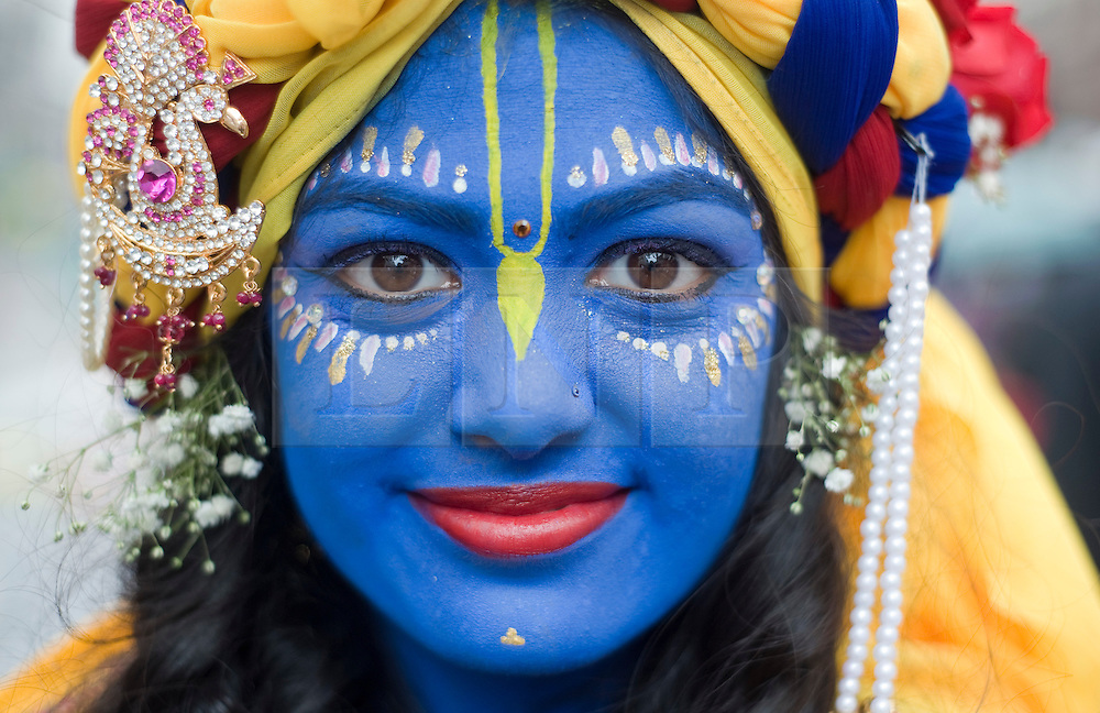 © licensed to London News Pictures. 12/06/2011. London, UK. A  girl with her face painted as Krishna during the Hare Krishna Ratha-yatra Festival of Chariots in London today (12/06/2011). 3 giant chariots are pulled from Hyde Park to Trafalger square accompanied by a procession of singers, musicians, and dancers. Rathayatra is celebrated by devotees of Lord Krishna all over the world. Photo credit should read: Ben Cawthra/LNP