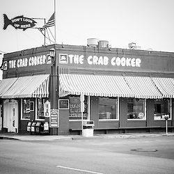 Crab Cooker Newport Beach black and white photo. The Crab Cooker is a popular landmark restaurant on Balboa Peninsula in Newport Beach, Orange County, California.  The Crab Cooker was originally a bank and was converted into a seafood restaurant.