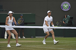 LONDON, July 14, 2018  Michael Venus (R) of New Zealand and Katarina Srebotnik of Slovenia compete during the mixed doubles semifinal match against Alexander Peya of Austria and Nicole Melichar of the United States at the Wimbledon Championships 2018 in London, Britain, July 13, 2018. Alexander Peya and Nicole Melichar won 2-0. (Credit Image: © Stephen Chung/Xinhua via ZUMA Wire)