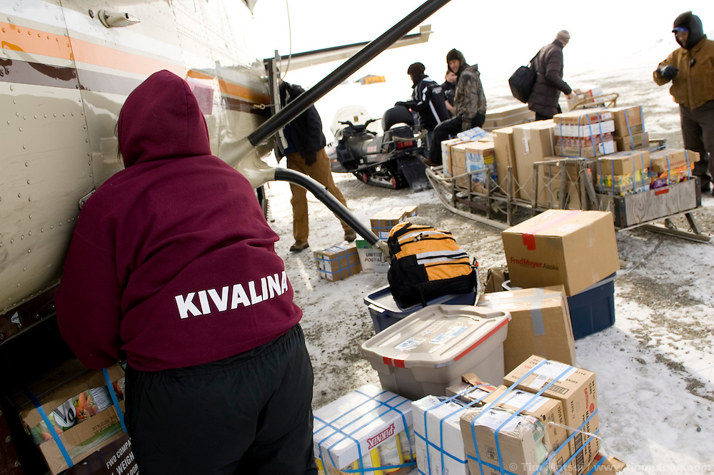 May 1, 2008 -- Kivalina, AK, U.S.A..Unloading a plane of supplies in Kivalina, Alaska. (Photo by Tim Matsui)