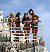 Michelle Rodriguez with girlfriends before jumping out of a cliff.Hotel Du Cap - 2007 Cannes Film Festival .Cap D'Antibes, France .Wednesday, May 24, 2007.Photo By Celebrityvibe; .To license this image please call (212) 410 5354 ; or.Email: celebrityvibe@gmail.com ;.
