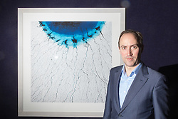 Bonhams, London, February 22nd 2017. Photographer Timo Lieber poses with his extraordinary large scale aerial photographs that capture the dangerous beauty of the melting of the polar ice cap. The collection of images serves to highlight the effects of climate change is currently exhibiting at Bonhams in London's Bond Street from February 20th to 23rd.
