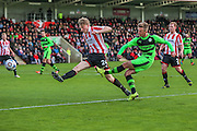 Forest Green Rovers Elliott Frear cross the ball during the Vanarama National League match between Cheltenham Town and Forest Green Rovers at Whaddon Road, Cheltenham, England on 21 November 2015. Photo by Shane Healey.