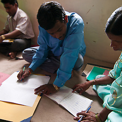 A social worker goes over and takes notes the VHW's records to see if there are any major problems in the villages.