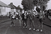 Teenage boys travel to a party, West London, UK, 1983