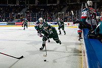 KELOWNA, CANADA - FEBRUARY 15:  Alex Swetlikoff #17 of the Kelowna Rockets back checks Gage Goncalves #39 of the Everett Silvertips as he skates along the boards with the puck during second period on February 15, 2019 at Prospera Place in Kelowna, British Columbia, Canada.  (Photo by Marissa Baecker/Shoot the Breeze)