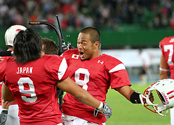 15.07.2011, Ernst Happel Stadion, Wien, AUT, American Football WM 2011, Japan (JAP) vs Mexico (MEX), im Bild Masayoshi Tsukada (Japan, #9, LB) and Tetsuo Takata (Japan, #8, QB) after the win // during the American Football World Championship 2011 game, Japan vs Mexico, at Ernst Happel Stadion, Wien, 2011-07-15, EXPA Pictures © 2011, PhotoCredit: EXPA/ T. Haumer