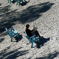 (02.03.2005)(PHOTO/CHIP LITHERLAND) -- Two men read on benches at Manatee Public Beach in Holmes Beach on Anna Maria Island in Holmes Beach Thursday, February 3, 2005.