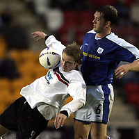 St Johnstone v Clyde..27.11.04<br />Aaron Wilford is tackled by Ian Maxwell<br /><br />Picture by Graeme Hart.<br />Copyright Perthshire Picture Agency<br />Tel: 01738 623350  Mobile: 07990 594431