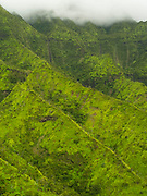 Aerial view of a waterfall, Kauai, Hawaii on a cloudy day.