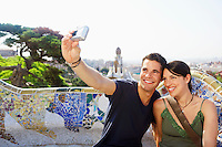 Smiling couple taking photo of themselves portrait