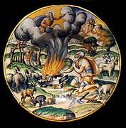 Decorative plate 'God Accepts Noah's Burnt Sacrifices'. Tin-enamelled earthenware, either maiolica or faience. From Lyon, mid-16th century. A scene from Genesis 8:20-22. Based on a woodcut by Bernard Salomon which was created for the vernacular Bibles published in Lyon in the 1550's.
