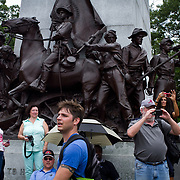 Visitors took pictures of Confederate living historians in front of the Robert E. Lee statue at the Virginia Memorial prior to the Pickett's Charge Commemorative March, during the Sesquicentennial Anniversary of the Battle of Gettysburg, Pennsylvania on Wednesday, July 3, 2013.  Thousands of visitors followed in the footsteps of the Confederate soldiers walking with living historians and park rangers along the path of the famously ill-fated Pickett's Charge, which brought to a close, The Battle of Gettysburg when the Union Army repelled their advance.  The Battle of Gettysburg lasted from July 1-3, 1863 resulting in over 50,000 soldiers killed, wounded or missing.  John Boal Photography