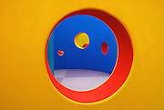 The Peek-A-Boo wall is a colorful maze of concentric, semi-circles at the new Dell Children's Hospital in Austin Texas on the site of the former Robert Mueller Airport. Designed by TBG Partners, the wall is part of the hospital's healing garden.