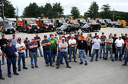 Workers from the Maine Department of Transportation wait for their hotel assignments Tuesday, September 6, 2011, after arriving in White River Junction to provide support to the Vermont Department of Transportation as roads were rebuilt following the previous week's flooding. About eighty men and women from the Maine Department of Transportation volunteered to come to Vermont with 25 dump trucks, four excavators, four loaders, and six back hoe loader combinations. <br /> Valley News - James M. Patterson<br /> jpatterson@vnews.com<br /> photo@vnews.com