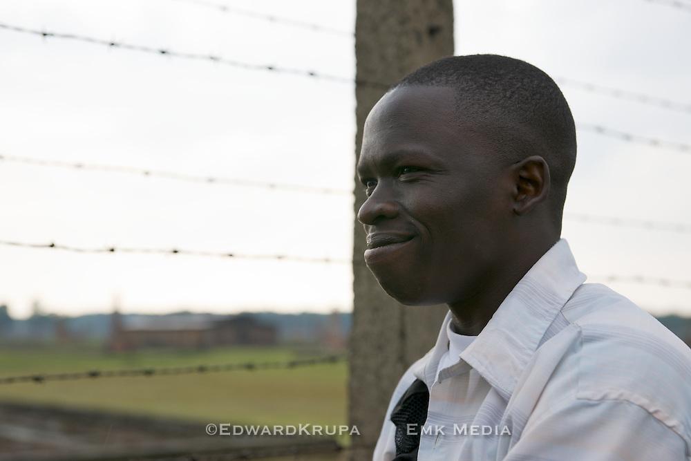 Rudy, a survivor of the war in Sudan, in Auschwitz, Birkenau.