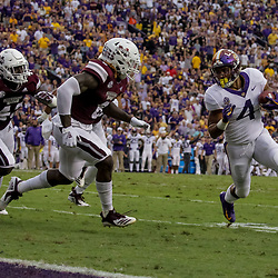 Oct 20, 2018; Baton Rouge, LA, USA; LSU Tigers running back Nick Brossette (4) is pursued by Mississippi State Bulldogs linebacker Willie Gay Jr. (6) during the first quarter at Tiger Stadium. Mandatory Credit: Derick E. Hingle-USA TODAY Sports
