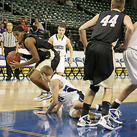 Lancer guard WIll Montgomery (5) wins the rebound and turns to move up court.