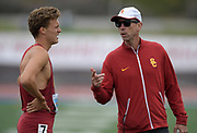 Apr 19, 2019; Torrance, CA, USA; Southern California Trojans distance coach Patrick Henner (right) talks with David Hulme during the 61st Mt. San Antonio College Relays at El Camino College.
