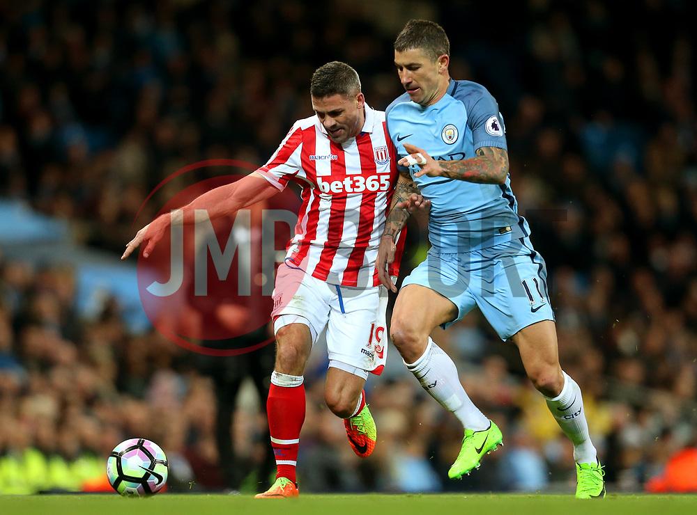 Jonathan Walters of Stoke City takes on Aleksandar Kolarov of Manchester City - Mandatory by-line: Matt McNulty/JMP - 08/03/2017 - FOOTBALL - Etihad Stadium - Manchester, England - Manchester City v Stoke City - Premier League