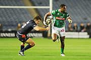 Ratuva Tavuyara slips past Chris Dean during the Guinness Pro 14 2018_19 match between Edinburgh Rugby and Benetton Treviso at Murrayfield Stadium, Edinburgh, Scotland on 28 September 2018.