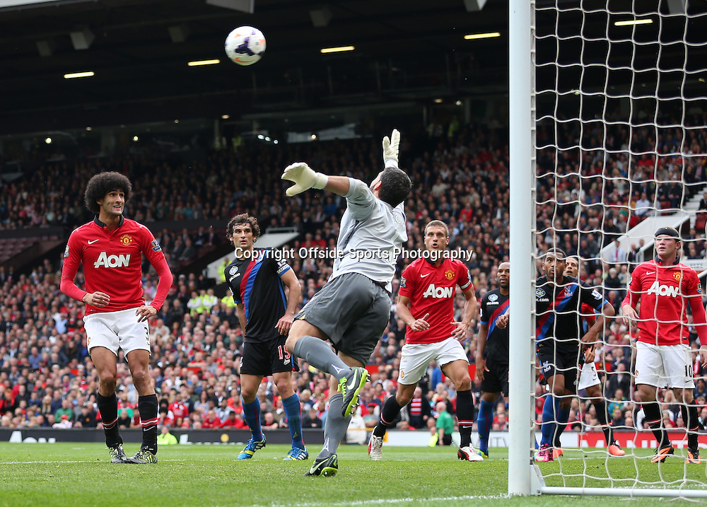 14th September 2013 - Barclays Premier League - Manchester United v Crystal Palace - Marouane Fellaini of Man Utd (L) looks on as Palace goalkeeper Julian Speroni dives for the ball - Photo: Simon Stacpoole / Offside.