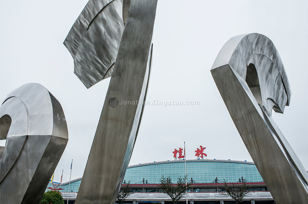 Low angle view of stainless steel sculptures in front of the main terminal building of the Guilin airport, China.