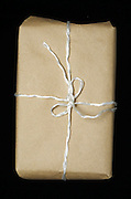 brown paper package tied up with string