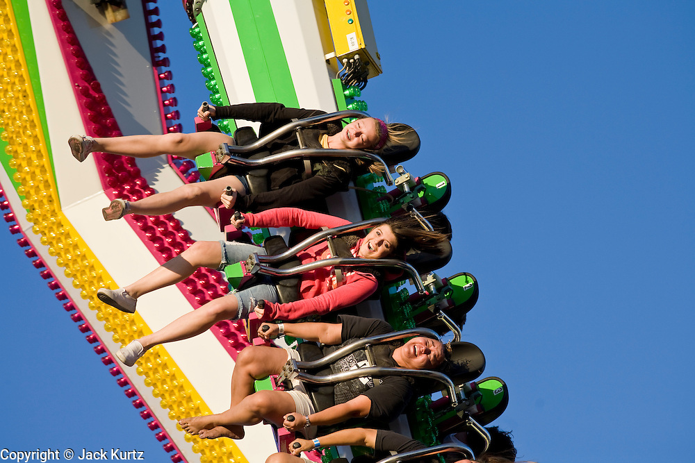 "Oct 14, 2008 -- PHOENIX, AZ: People ride the ""Tango"" thrill ride at the Arizona State Fair Tuesday. The Arizona State Fair started Oct.  10 and runs through Nov. 2. Carnival and midway workers who have worked the fair for years say attendance so far is much lower than in the past and people at the fair this year aren't spending as much money as they have in the past. Photo by Jack Kurtz / ZUMA Press"