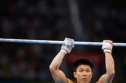 China's Li Xiaopeng competes on the high bar for artistic gymnastics men's team during the Olympic games in Beijing, China, 12 August 2008. The Chinese won the gold medal for the event with Japan and United States taking silver and bronze respectively.
