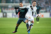 Warsaw, Poland - 2017 February 16: (R) Valeri Kazaishvili of Legia Warsaw fights for the ball with (L) Kenny Tete of Ajax Amsterdam during soccer match Legia Warszawa v Ajax Amsterdam - UEFA Europe League  at Municipal Stadium on February 16, 2017 in Warsaw, Poland.<br /> <br /> Mandatory credit:<br /> Photo by &copy; Adam Nurkiewicz / Mediasport<br /> <br /> Adam Nurkiewicz declares that he has no rights to the image of people at the photographs of his authorship.<br /> <br /> Picture also available in RAW (NEF) or TIFF format on special request.<br /> <br /> Any editorial, commercial or promotional use requires written permission from the author of image.