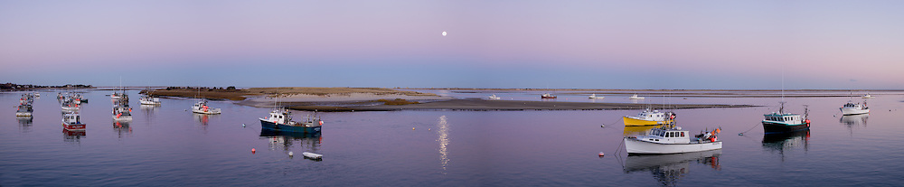 The full moon rises over Aunt Lydia's Cove at the Chatham fish pier.