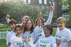Westminster, London, June 6th 2016.The judge prepares for another match as teams from uk industry as well as the House of Commons and the House of Lords compete in the annual McMillan Cancer Charity tug o' war. PICTURED: Jo Cox, front left, poses with the women's House of Commons tug of war team.