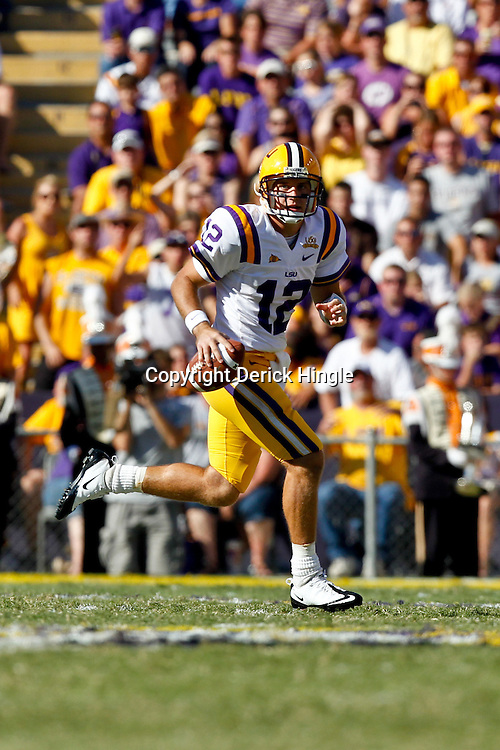 Oct 2, 2010; Baton Rouge, LA, USA; LSU Tigers quarterback Jarrett Lee (12) scrambles as he looks to pass against the Tennessee Volunteers during the second half at Tiger Stadium. LSU defeated Tennessee 16-14.  Mandatory Credit: Derick E. Hingle