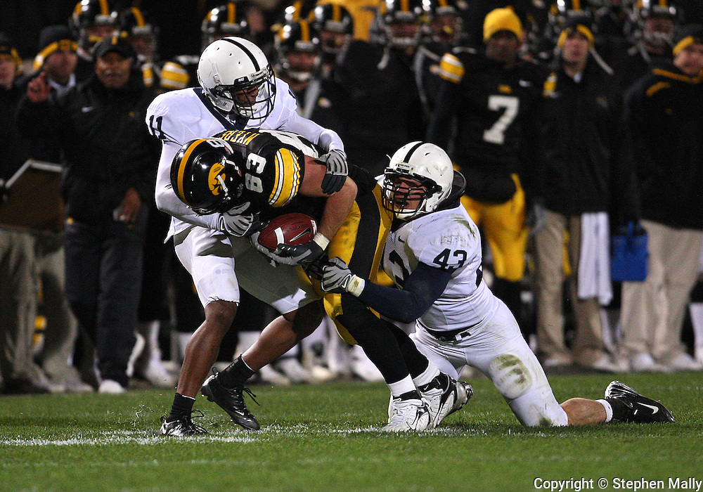 08 NOVEMBER 2008: Iowa tight end Brandon Myers (83) is pulled down by Penn State safety Tony Davis (11) and Penn State linebacker Josh Hull (43) after an 11 yard reception in the second half of an NCAA college football game against Penn State, at Kinnick Stadium in Iowa City, Iowa on Saturday Nov. 8, 2008. Iowa beat Penn State 24-23.