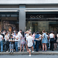 MILAN, ITALY - JULY 03:  Shoppers queue in front of the Gucci store in Via Montenapoleone in Milan on the first day of the Summer Sales on July 3, 2010 in Milan, Italy. Milan's summer sales start today. .***Agreed Fee's Apply To All Image Use***.Marco Secchi /Xianpix. tel +44 (0) 207 1939846. e-mail ms@msecchi.com .www.marcosecchi.com