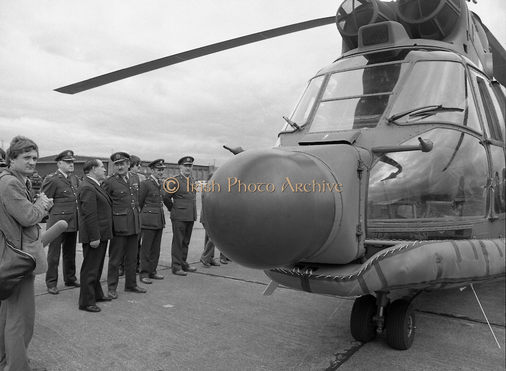 """Air Corps Takes Delivery Of Puma Helicoptor. (N86)..1981..22.07.1981..07.22.1981..22nd July 1981..The Air Corps took delivery,today, of a new French Built SA 330 J """"Puma"""" Helicoptor. The """"Puma"""" escorted by another Air Corps helicoptor landed at Casement Aerodrome, Baldonnell,Co Dublin...The Minister for Defence, James Tully TD, and some of the military high command get a close up view of the new addition to the Air Corps fleet."""