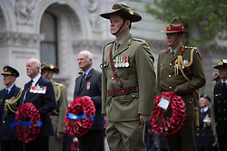 The Anzac Day tradition -WW1 memorial. Australian servicemen stand during the ANZAC day at The Centotaph in a service of remembrance. Whitehall, London, United Kingdom. Friday, 25th April 2014. Picture by Daniel Leal-Olivas / i-Images