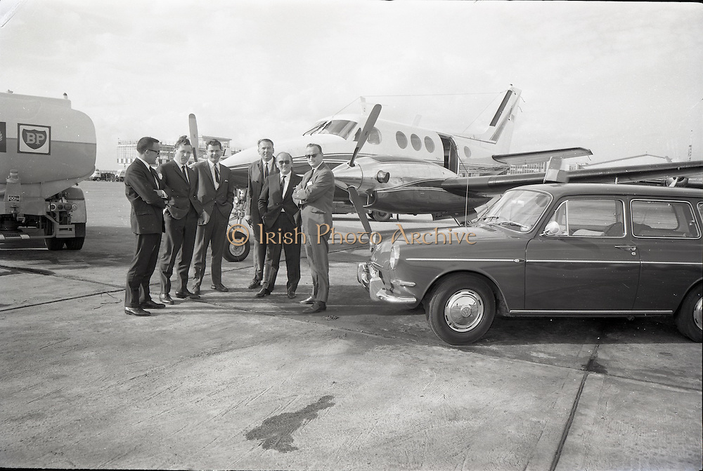 25/06/1965<br /> 06/25/1965<br /> 25 June 1965<br /> Arrival of Dr Carl H. Hahn of Volkswagen at Dublin Airport.<br /> Dr. Hahn, Sales and Service Director, Volkswagenwerke, A.G., Germany, arrived in Ireland on the company plane. He was President of Volkswagen of America. He had recently returned to Wolfsburg and was visiting Ireland as part of a brief European tour to familiarise himself with local conditions. Image shows on left Mr. Michael P. O'Flaherty, Chairman Volkswagen Distributers Ltd. and  Mr. Dermod Ryan, General Manager Volkswagen Distributers Ltd., on right are Dr. Hahn and Mr. Stephen O'Flaherty. In centre are Mr. E. Schneider and Mr. U. (?) P. Kiesewetter, Factory Delegates for North West Europe. Aircraft is a Beechcraft Kingaire. Car appears to be a Volkswagen Type 3.