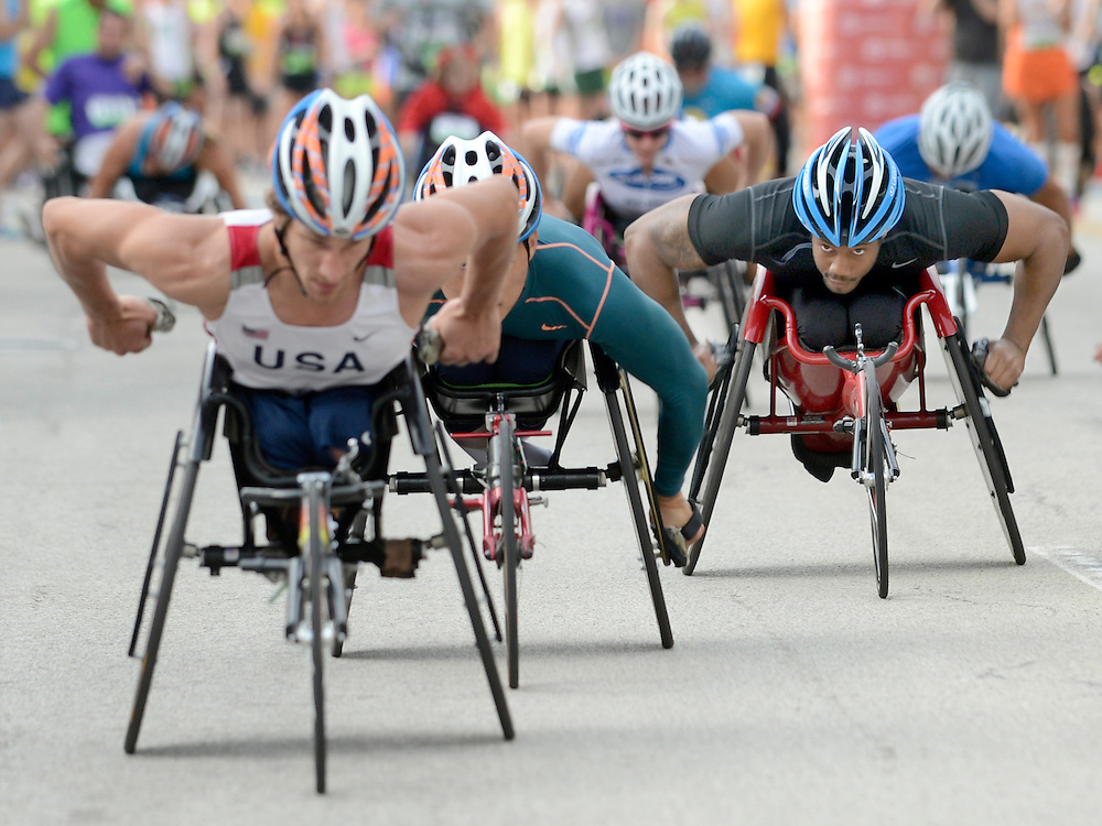 Steamboat Classic wheelchair competitors vie for position at the start of the 41st annual race in dowtown Peoria Saturday.